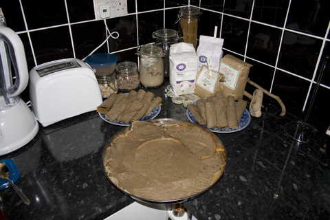All of the prepared injera: two dishes for the injera servings and the main serving platter, ready for the Ethiopian stews
